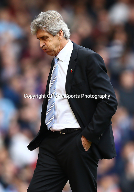 25 October 2014 - Barclays Premier League - West Ham v Manchester City - A frustrated Manuel Pellegrini, Manager of Manchester City puffs out his cheeks - Photo: Marc Atkins / Offside.