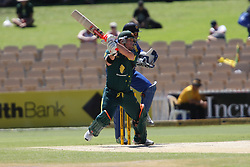 © Licensed to London News Pictures. 08/03/2012. Adelaide Oval, Australia. Australian opening batsmen David Warner plays a cut shot during the One Day International cricket match final between Australia Vs Sri Lanka. Photo credit : Asanka Brendon Ratnayake/LNP