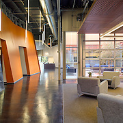 Carrier Johnson Architects designed the Helix Electric San Diego offices in 2013. The style is stealth fighter cool with a touch of non-combatant color.