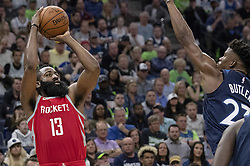 April 23, 2018 - Minneapolis, MN, USA - Houston Rockets' James Harden (13) is defended by Timberwolves' Jimmy Butler (23) in the third quarter in Game 4 of their series Monday, April 23, 2018 at the Target Center in Minneapolis, Minn. The Rockets won, (Credit Image: © Carlos Gonzalez/TNS via ZUMA Wire)