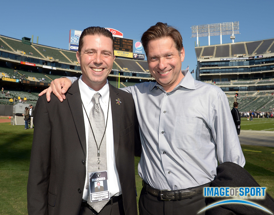Nov 24, 2013; Oakland, CA, USA; Will Kiss (left) and broadcaster Greg Papa attend the game between Tennessee Titans and the Oakland Raiders at O.co Coliseum.