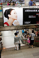 people in a metro station in Shanghai China