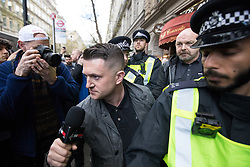 © Licensed to London News Pictures . 01/04/2017 . London , UK . Police separate anti fascists and Tommy Robinson at Trafalgar Square . The EDL and Britain First both hold demonstrations in London , opposed by anti-fascist groups , including Unite Against Fascism . Photo credit : Joel Goodman/LNP