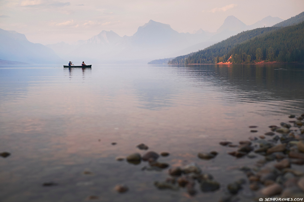 Canoe the tranquil water of Lake McDonald, Glacier National Park, Montana.