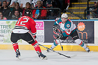 KELOWNA, CANADA - MAY 1: Miles Koules #12 of Portland Winterhawks checks Dillon Dube #19 of Kelowna Rockets during first period of game 5 of the Western Conference Final on May 1, 2015 at Prospera Place in Kelowna, British Columbia, Canada.  (Photo by Marissa Baecker/Getty Images)  *** Local Caption *** Miles Koules; Dillon Dube;