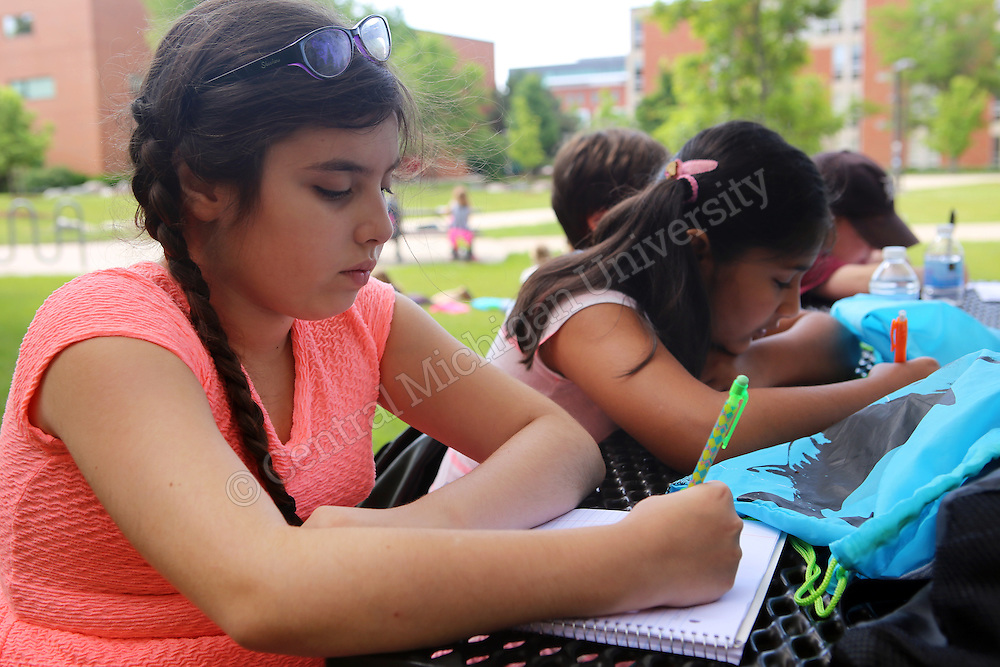 Students work on their writing during the Chippewa River Writing Camp photo by Emily Mesner