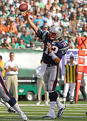 Sept 19, 2011; East Rutherford, NJ, USA; New England Patriots quarterback Tom Brady (12) throws a pass during the 1st half of their game against the New York Jets at the New Meadowlands Stadium.