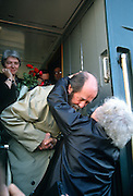 Russian Nobel prize novelist Alexander Solzhenitsyn is greeted by a well-wisher after arriving by train returning to his homeland as his wife Alya Svetlova looks on June 5, 1994 in Khabarovsk, Russia. Solzhenitsyn was expelled from the Soviet Union in 1974 but returned after the fall of the Soviet Union.