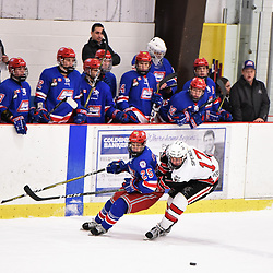 GEORGETOWN, ON - JANUARY 5: Ryan O'Hara #25 of the Oakville Blades and Grant Spence #17 of the Georgetown Raiders battle for the puck in the first period on January 5, 2019 at Gordon Alcott Memorial Arena in Georgetown, Ontario, Canada.<br /> (Photo by Ken Lamb / OJHL Images)