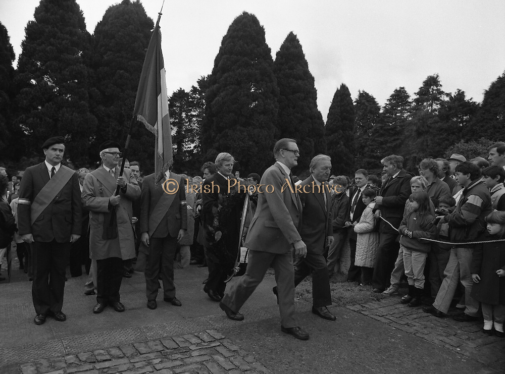 Annual Wolfe Tone Commemoration.  (R65)..1987..11.10.1987..10.11.1987..11th October 1987..The annual Fianna Fáil Wolfe Tone commemoration was held at Bodenstown today, the keynote oration was given by An Taoiseach, Charles Haughey TD...Image shows An Taoiseach, Charles Haughey, moving forward to lay a wreath at the memorial to Wolfe Tone.