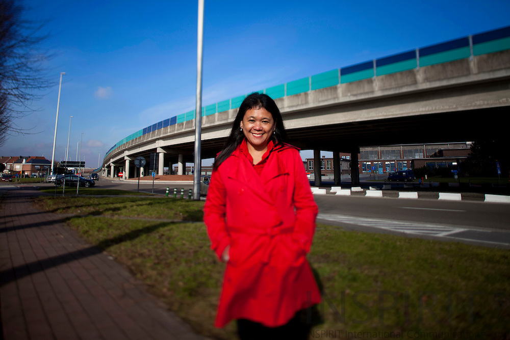 BRUSSELS - BELGIUM - 03 MARCH 2010 --  Mitzi Zaruk, Managing Director for ENGAGED Partnerships for Change in front of a highway bridge connecting Brussels and the Airport in Zaventem outside Brussels. Behind some factory buildings  PHOTO: ERIK LUNTANG / INSPIRIT