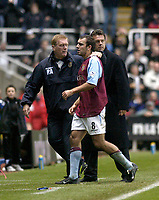 Photo. Glyn Thomas.<br /> Newcastle United v Aston Villa. Barclaycard Premiership.<br /> St James' Park, Newcastle. 01/11/03.<br /> Villa's Gavin McCann (C) is escorted from the field by his manager David O'Leary (L) after being sent off.