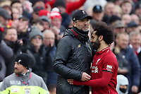 Football - 2018 / 2019 Premier League - Liverpool vs. Chelsea<br /> <br /> Liverpool Manager Jurgen Klopp  embraces Mohamed Salah after he has been substituted, at Anfield.<br /> <br /> COLORSPORT/PAUL GREENWOOD