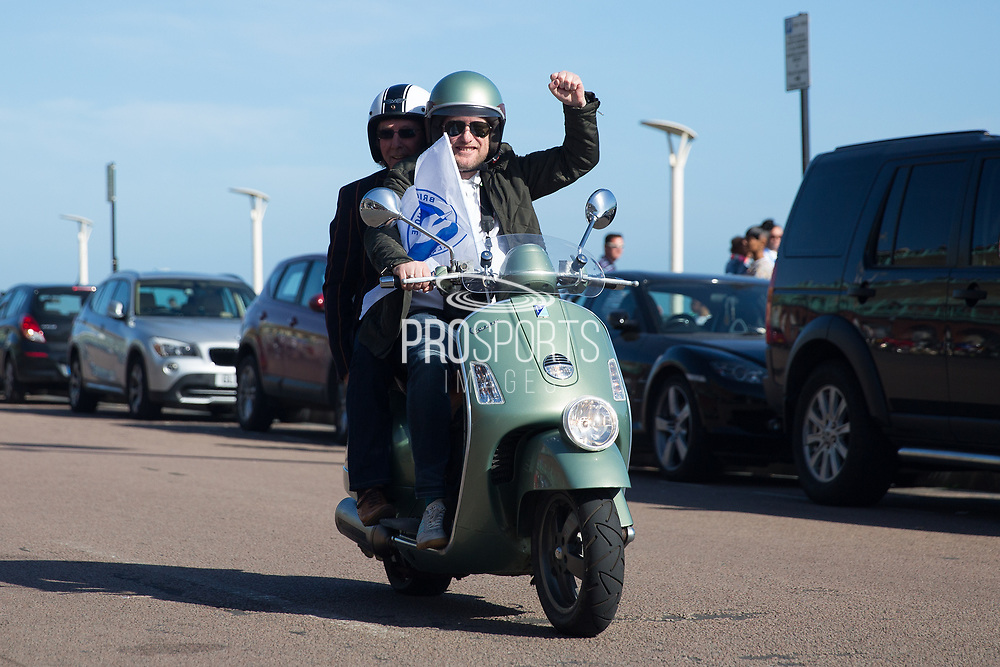 Mod scooterist during the Brighton & Hove Albion Football Club Promotion Parade at Brighton Seafront, Brighton, East Sussex. United Kingdom on 14 May 2017. Photo by Ellie Hoad.