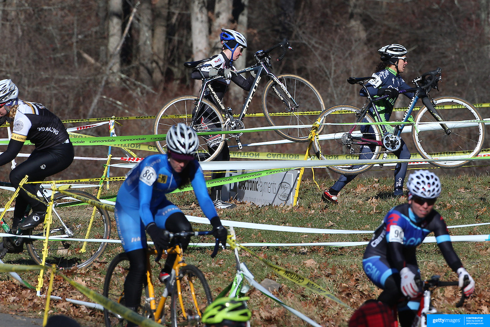 Competitors Christina Birch, (top, centre), and Lori Cooke, (top, right) in action during the Cyclo-Cross, Supercross Cup 2013 UCI Weekend at the Anthony Wayne Recreation Area, Stony Point, New York. USA. 24th November 2013. Photo Tim Clayton