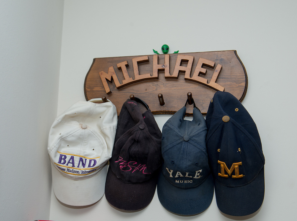 December 5, 2015 - Fairfax, VA - A day in the life of &quot;Doc Nix,&quot; aka Dr. Michael Nickens, the Director of the Athletic Bands for George Mason University. Here hats represent the various alma maters of Doc Nix.<br /> <br /> <br /> Photo by Susana Raab