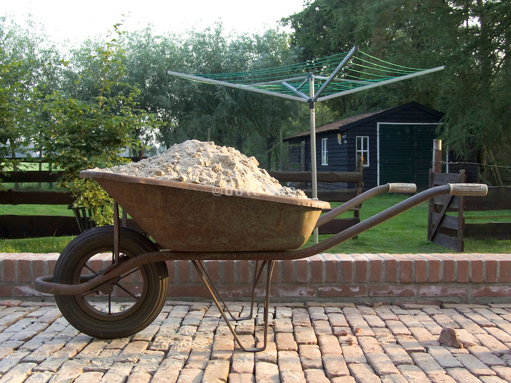 wheelbarrow filled with sand