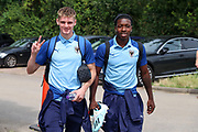 AFC Wimbledon Jack Rudoni (12) and AFC Wimbledon attacker Michael Folivi (17) arriving during the EFL Sky Bet League 1 match between AFC Wimbledon and Rotherham United at the Cherry Red Records Stadium, Kingston, England on 3 August 2019.