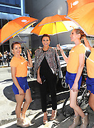 IMAGE DISTRIBUTED FOR ACCUWEATHER -  Andi Dorfman is shaded from the hot summer sun by the AccuWeather MinuteCast street team at New York Fashion Week, on Tuesday, Sept. 15, 2015. The AccuWeather MinuteCast Street Team is at it again helping Fashion Week attendees stay stylish and one-step ahead of any possible precipitation. (Photo by Diane Bondareff/Invision for AccuWeather/AP Images)