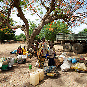 April 28, 2012 - Buram, Nuba Mountains, South Kordofan, Sudan: A group of Nuba people rests under the shade of a tree before continue the three to four day journey to a refugee camp in the neighbor South Sudan. Thousands of people have in the past months fled the bombardments and hunger in South Kordofan...Since the 6th of June 2011, the Sudan's Army Forces (SAF) initiated, under direct orders from President Bashir, an attack campaign against civil areas throughout the South Kordofan's province. Hundreds have been killed and many more injured...Local residents, of Nuba origin, have since lived in fear and the majority moved from their homes to caves in the nearby mountains. Others chose to find refuge in South Sudan, driven by the lack of food cause by the agriculture production halt due to the constant bombardments of rural areas. (Paulo Nunes dos Santos/Polaris)