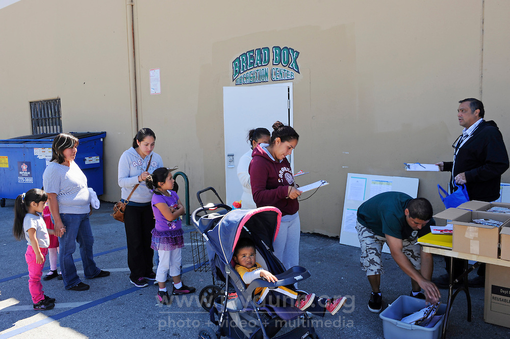 Family members sign up to receive basics as well as occasional fresh vegetables at The Breadbox Center in east Salinas, a bimonthly distribution point supplied by the Food Bank of Monterey County.