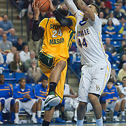 02/01/12 Newark DE: George Mason Senior Forward Ryan Pearson #24 attempts a lay up as Delaware Junior Forward #44 Jamelle Hagins defends during a Colonial Athletic Association conference Basketball Game against Delaware Wed, Feb. 1, 2012 at the Bob Carpenter Center in Newark Delaware.