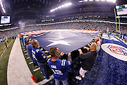 Fans hold a giant American flag during the playing of the National Anthem before the Indianapolis Colts NFL week 2 regular season football game against the Philadelphia Eagles on Monday, Sept. 15, 2014 in Indianapolis. The Eagles won the game 30-27. ©Paul Anthony Spinelli