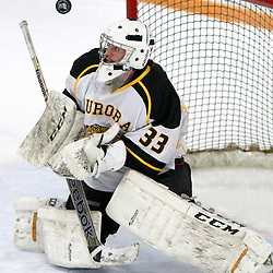 AURORA, ON - Jan 11 : Ontario Junior Hockey League Game Action between the Lindsay Muskies and the Aurora Tigers, Andrew Munroe #33 of the Aurora Tigers Hockey Club makes the save during second period game action.<br /> (Photo by Brian Watts / OJHL Images)