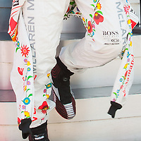 McLaren Formula One driver Lewis Hamilton of Britain wears a Kalocsa design outfit before the free practice of the Hungarian F1 Grand Prix in Mogyorod (about 20km north-east from Budapest), Hungary. Saturday, 30. July 2011. ATTILA VOLGYI.Team sponsor Hugo Boss celebrates its 30th anniversary with special fan made designs for competition saturdays on all races. On Hungaroring the special design is from Hungarian folk tradition with motives from Kalocsa..