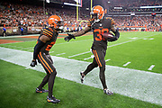 Cleveland Browns defensive back Terrance Mitchell (39) celebrates with Cleveland Browns rookie cornerback Denzel Ward (21) after intercepting a late fourth quarter pass that clinches the Browns first win since 2016 during the 2018 NFL regular season week 3 football game against the New York Jets on Thursday, Sept. 20, 2018 in Cleveland. The Browns won the game 21-17. (©Paul Anthony Spinelli)
