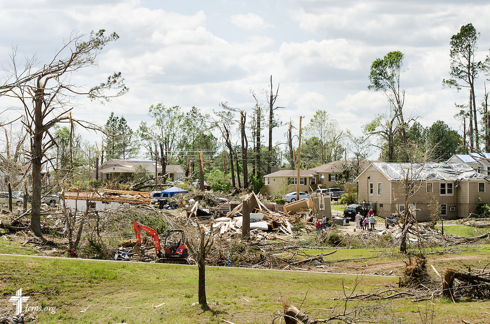 Residents return to their homes in Tupelo, Miss., on Friday, May 2, 2014. A tornado ravaged the community earlier in the week. LCMS Communications/Erik M. Lunsford