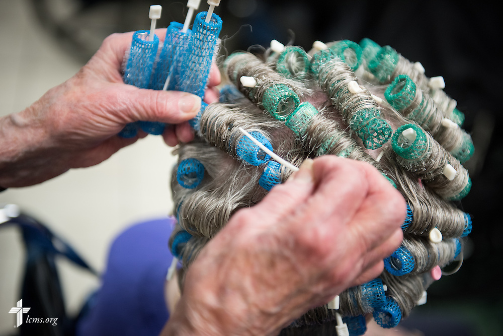 89 year-old volunteer Ruth Martens, a member of Saint Peter-Immanuel Lutheran Church in Milwaukee, removes curlers from the hair of a Lutheran Home resident within the Bunny's Boutique beauty shop located at the Lutheran Home where she has been a volunteer for 19 years on Wednesday, May 20, 2015, in Milwaukee, Wis. LCMS Communications/Erik M. Lunsford