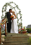 Cyril and Chelsea kiss at their outdoor wedding ceremony.  Private residence, Sandy (near Salt Lake City), Utah...Photo © http://gsilvaphoto.com Beautiful, professional, yet affordable wedding photography.