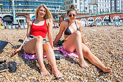 © Licensed to London News Pictures. 07/05/2018. Brighton, UK. (L to R) 20 year olds VICKY FLOOD and NICOLE ALLEN from Haywards Heath spent the day on Brighton and Hove beach on the May Bank Holiday Monday as warm weather continues to hit the seaside resort. This weekend has been the hottest May Bank Holiday weekend on record. Photo credit: Hugo Michiels/LNP