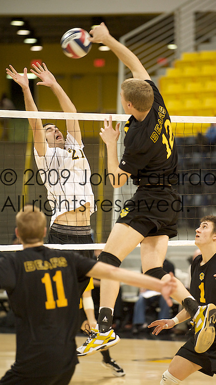 03Jan09 Long Beach, CA-  49er Dan Alexander(21) attempts to block Justin Merta(12) at the net.  49ers get their first win of the season beating the University of Alberta three games to one.