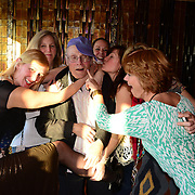 Fans with legendary photo journalist Joe Stevens at a party after hearing him talk about his life photographing some of the music industry's major artists, during the 2013 Portsmouth Singer Songwriter Festival, at The Loft in Portsmouth, NH.