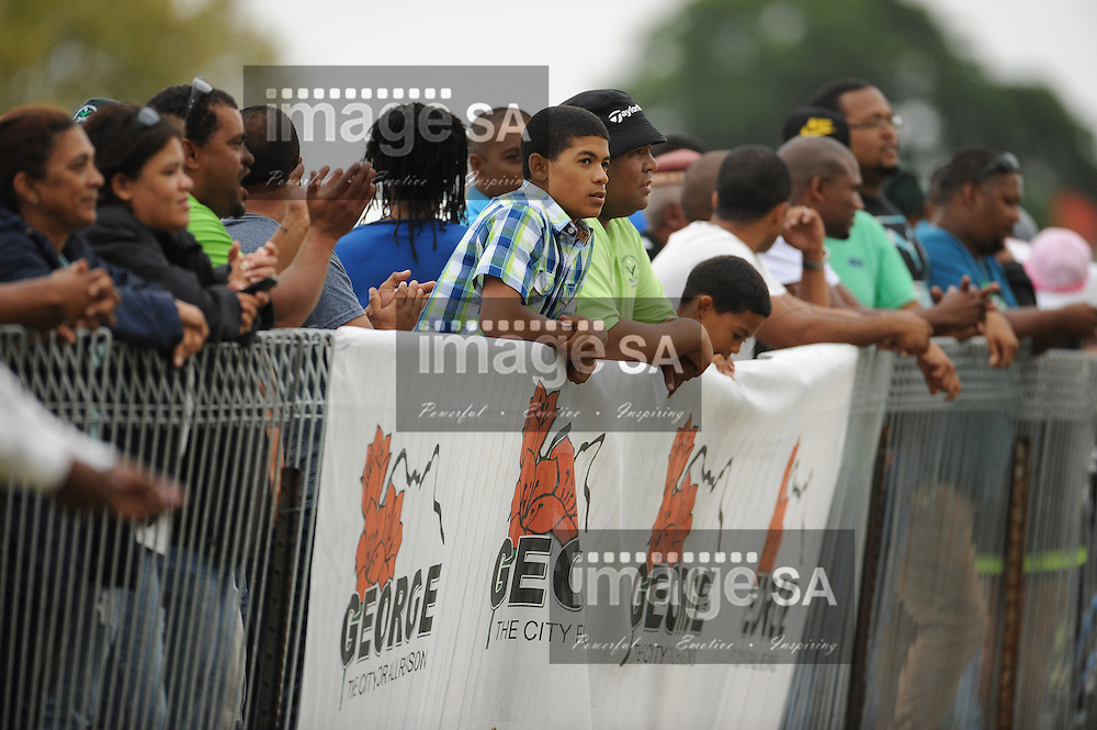 GEORGE, SOUTH AFRICA - Saturday 7 March 2015, spectators cheer and hold their breath during the third round match of the Cell C Community Cup between Pacaltsdorp Evergreens and Vaseline Wanderers at Pacaltsdorp Sports Grounds, George<br /> Photo by Roger Sedres/ImageSA/ SARU