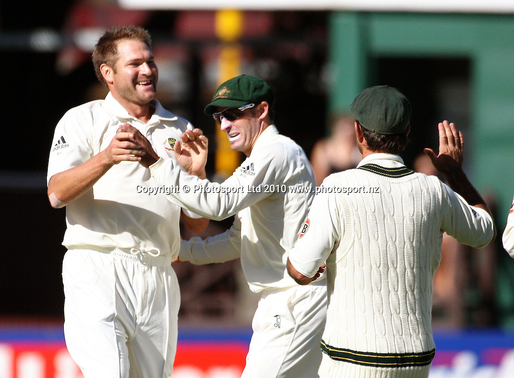 Australian bowler Ryan Harris celebrates dismissing Brendon McCullum for 104 with teammates Mike Hussey and Ricky Ponting (right).<br /> 1st cricket test match - New Zealand Black Caps v Australia, day five at the Basin Reserve, Wellington. Tuesday, 23 March 2010. Photo: Dave Lintott/PHOTOSPORT