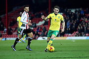 Norwich City midfielder Robbie Brady (12) dribbling during the EFL Sky Bet Championship match between Brentford and Norwich City at Griffin Park, London, England on 31 December 2016. Photo by Matthew Redman.