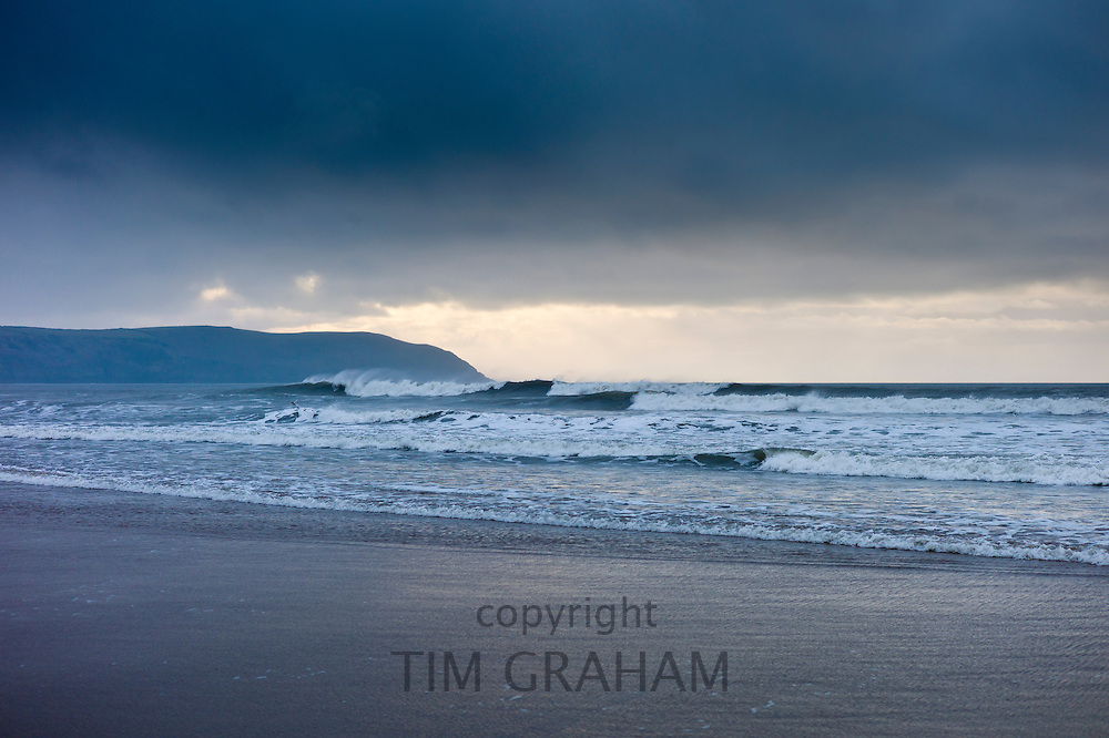 Waves crashing onto the beach at Woolacombe, North Devon, UK