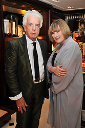 NICKY HASLAM and SUE CREWE at a signing of Redeeming Features - Nicky Haslam's autobiography hosted by House & Garden magazine held at Ralph Lauren, Bond Street, London on 29th October 2009.