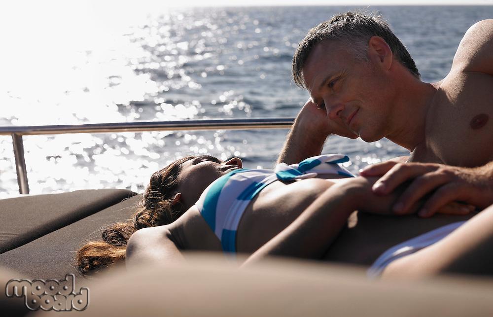 Couple Sunbathing on Boat