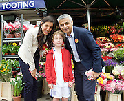 Sadiq Khan Mayor of London joins Dr Rosena Allin-Khan leafletting and speaking with voters outside Tooting Broadway Station for the Tooting by-election.<br /> 16th June 2016 <br /> <br /> Sadiq Khan <br /> Dr Rosena Allin-Khan <br />  with Jack, a young England supporter <br /> <br /> Photograph by Elliott Franks <br /> Image licensed to Elliott Franks Photography Services