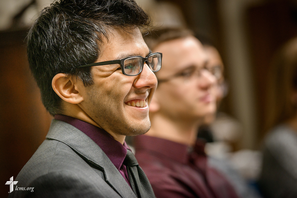 Brandon Price reacts as the Rev. Eric R. Andræ, associate pastor for campus and international ministry at First Trinity Evangelical–Lutheran Church and Luther House student center, leads student Bible study on Sunday, Nov. 20, 2016, at the church in Pittsburgh. LCMS Communications/Erik M. Lunsford