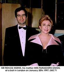 MR PAVLOS HORNE, his mother MRS PANAGIOTIS LEMOS,  at a ball in London on January 30th 1997.LWE 71