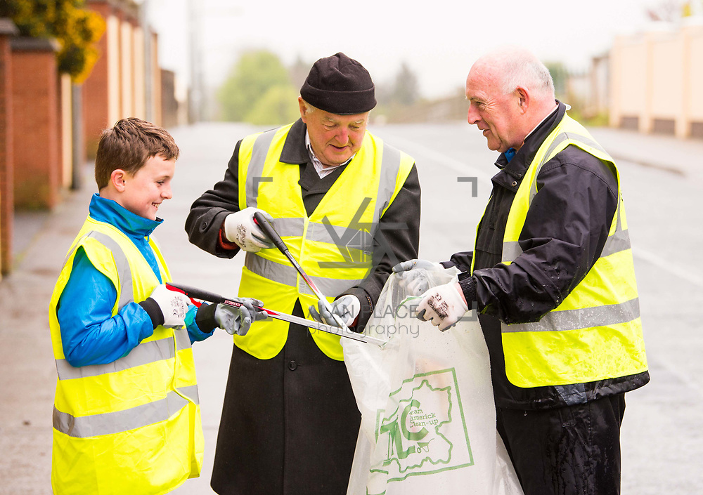 14/04/2017<br /> Europe's biggest ever clean-up took place across Limerick today. Over 16,500 volunteers took to the streets of Limerick city and county to take part in Team Limerick Clean-up (TLC3)<br />  Pictured taking part in Team Limerick Clean-Up in Monaleen, Limerick, are Leo Morrison, left, Eoghan Kelliher, aged 11, along with his dad, Mick Kelliher. Picture: Diarmuid Greene/Alan Place Photography