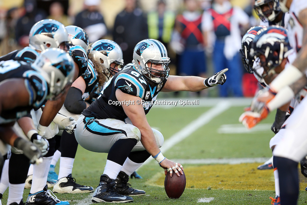 Carolina Panthers center Ryan Kalil (67) points at the defensive alignment as the Panthers offensive line gets set at the line of scrimmage opposite the Denver Broncos defensive line during the NFL Super Bowl 50 football game against the Denver Broncos on Sunday, Feb. 7, 2016 in Santa Clara, Calif. The Broncos won the game 24-10. (©Paul Anthony Spinelli)