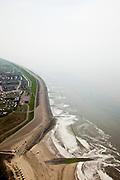 Nederland, Noord-Holland, Gemeente Zijpe, 28-04-2010; Petten met Pettemer Zeewering, gezien naar het noorden, naar de Hondsbossche zeewering. De dijk is aangelegd als zeewering nadat de oorsrponkelijke duinen weggeslagen waren. Door erosie kalven de duinen langs de kust steeds verder af, de dijk steekt daardoor steeds meer uit in zee..Petten with Petten Seawall, noth in the direction of the Hondsbossche seawall). The dike was built as a seawall after the primal dunes were washed away. Because of erosion the dunes decrease in size, therefore the sewall sticks more and more out into the sea..luchtfoto (toeslag), aerial photo (additional fee required).foto/photo Siebe Swart
