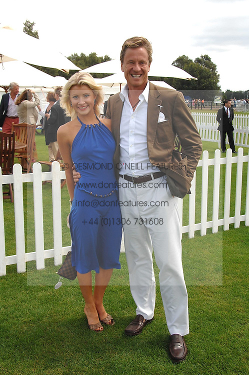 ROBERT HERSOV and DR KATIE JAMES at the Cartier International polo at Guards Polo Club, Windsor Great Park on 29th July 2007.<br /><br />NON EXCLUSIVE - WORLD RIGHTS