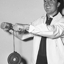 Golfer Gary Player demonstrating his excerciser at a Broadstreet Store. July 24 1961